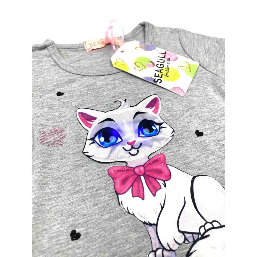 kislány zsebes szürke színű tunika, elején cica minta, a szeme érintésre világít, közeli